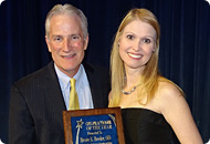 Dr. Ed Bennett giving Dr. Renee Reeder the Practitioner of the Year award.