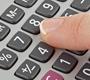 Someone using calculator